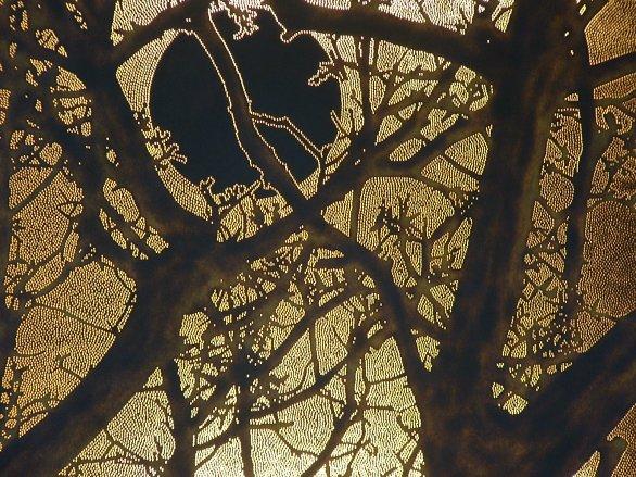 Moon through walnut tree